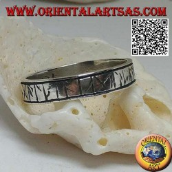 Silver ring with engraved Celtic runes