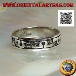 "Silver band ring worked with ""Omega"" symbol in bas-relief"