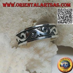 Silver ring with tribal waves in bas-relief
