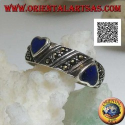 Silver ring with natural lapis lazuli hearts in relief on oblique processing with marcasite