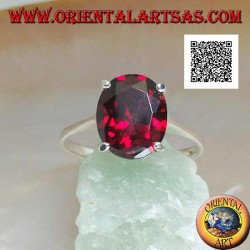 Rhodium silver ring with faceted oval cabochon garnet set with 4 clips