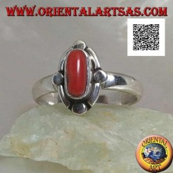 Silver ring with oval natural coral surrounded by alternating bands and discs