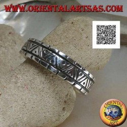 Silver ring with engravings of various geometric shapes