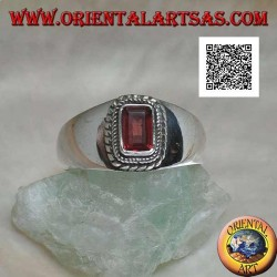 Silver ring with raised rectangular natural garnet surrounded by a double weave