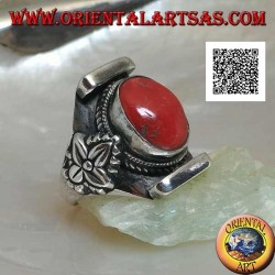 Silver ring with oval antique Tibetan coral in Nepalese setting with leaf on the sides
