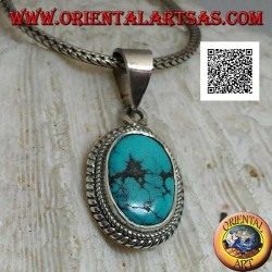 Silver pendant with antique oval Tibetan turquoise surrounded by a small and large double weave