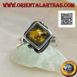 Silver ring with square green amber mounted in a rhombus and two wires on the edges