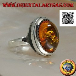 Silver ring with raised oval cabochon amber surrounded by triangles