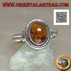 Two silver ring with oval amber with smooth outline and two lateral lines