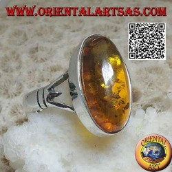 Silver ring with an elongated oval cabochon amber attached to two