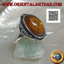 Silver ring with cabochon oval amber with two balls and a leaf on the edge (thin)