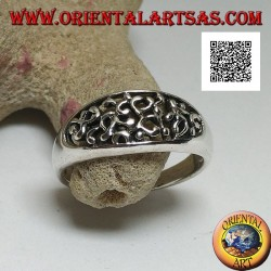 Silver ring with dense openwork decoration on a horizontal oval