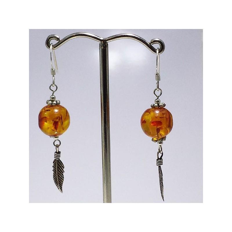 orecchini sfera in Ambra con piuma in argento