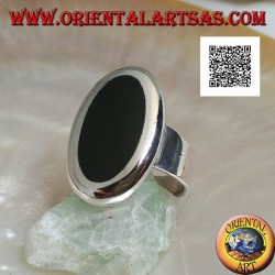 Silver ring with oval onyx set flush with the edge with smooth contour