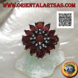 Silver ring with raised flower of 13 natural round, shuttle and drop shaped garnets, set