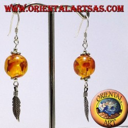Ball earrings in silver with amber feather