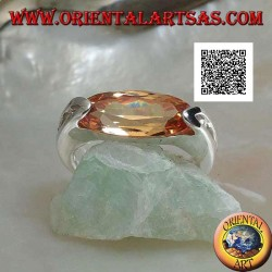Rhodium silver ring with narrow oval faceted champagne zircon hooked on the side