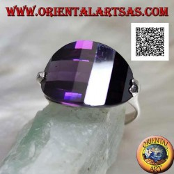 Rhodium-plated silver ring with rounded oval amethyst-colored zircon attached to the side