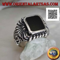 Silver ring with rectangular beveled onyx and curved lines pattern engraved in relief