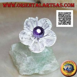 Flower-shaped satin silver ring with long pistils and faceted amethyst-colored zircon sphere