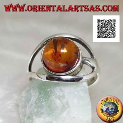 Silver ring with cabochon round amber between two curved lines in silver
