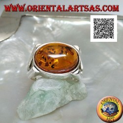 Silver ring with oval cabochon amber crosswise on smooth setting with lateral opening