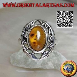 Silver ring with cabochon oval amber between two laurel branches