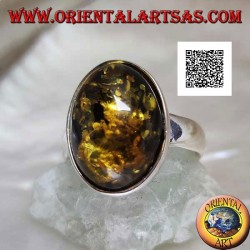 Silver ring with oval cabochon green amber on simple setting and smooth edge