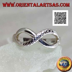 Silver ring with infinity knot symbol with one smooth line and the other snake skin
