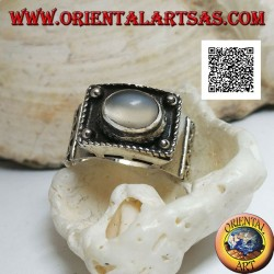 Silver band ring with raised cabochon oval moonstone and ethnic decorations