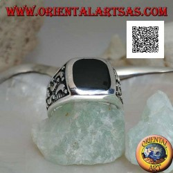Silver ring with rounded rectangular onyx and moons cut on the sides