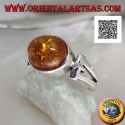 Silver ring with oval cabochon amber crosswise with elongated triangular hole