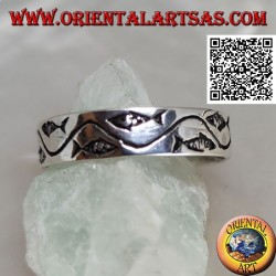 Silver ring with stylized fish separated by a curved line