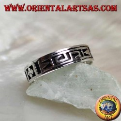 Silver ring with a geometric motif between stylized dorje engraved twice