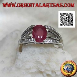 Silver ring with natural oval ruby set with two lines of zircons and two of silver