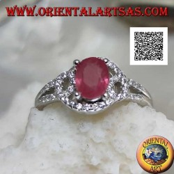 Silver ring with natural oval ruby set on intertwined lines of white zircons