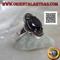 Silver ring with oval amethyst set between four semicircles studded with marcasite