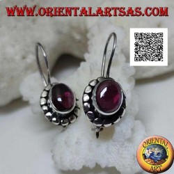 Silver earrings with oval cabochon natural garnet surrounded by disks with silver studs