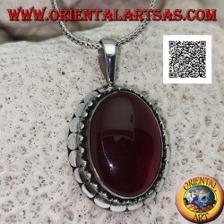 Silver pendant with large oval cabochon carnelian surrounded by trio of balls and studs