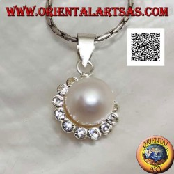 Silver flower pendant with central white pearl surrounded by small white zircons
