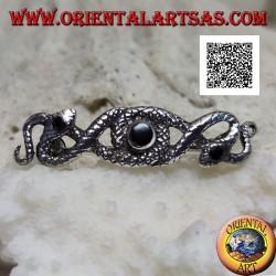 Spilla in argento a forma di due serpenti intrecciati tra loro con onice centrale e sugli occhi