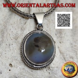 Silver pendant with cabochon oval tourmalinated quartz surrounded by weaving