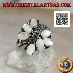 Silver ring with seven oval mother-of-pearl set separated by a curved line of marcasite