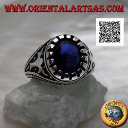 Silver ring with faceted oval synthetic sapphire with imperial motif engraved on the sides