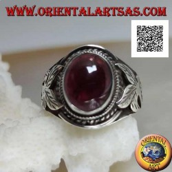Silver ring with oval cabochon natural garnet and flower on the sides