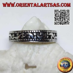 Silver ring with moons and stars on a hollowed background