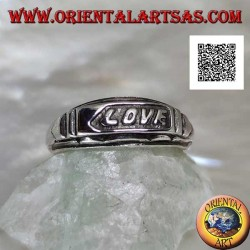 "Silver ring with ""LOVE"" writing in bas-relief on a plate"