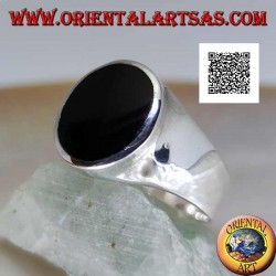 Silver ring with oval onyx flush with slightly raised edge on smooth frame