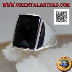 Silver ring with slightly raised rectangular curved faceted onyx on smooth setting