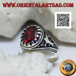 Silver ring with faceted oval garnet with imperial motif engraved on the sides